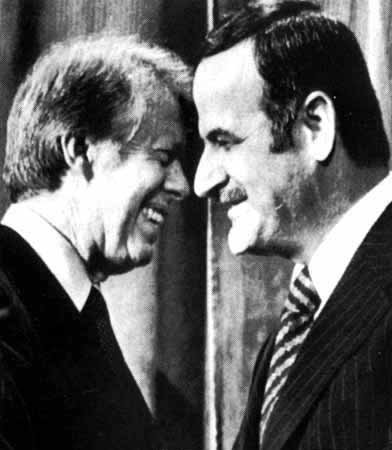 Jimmy Carter and Assad: Why are these men smiling?